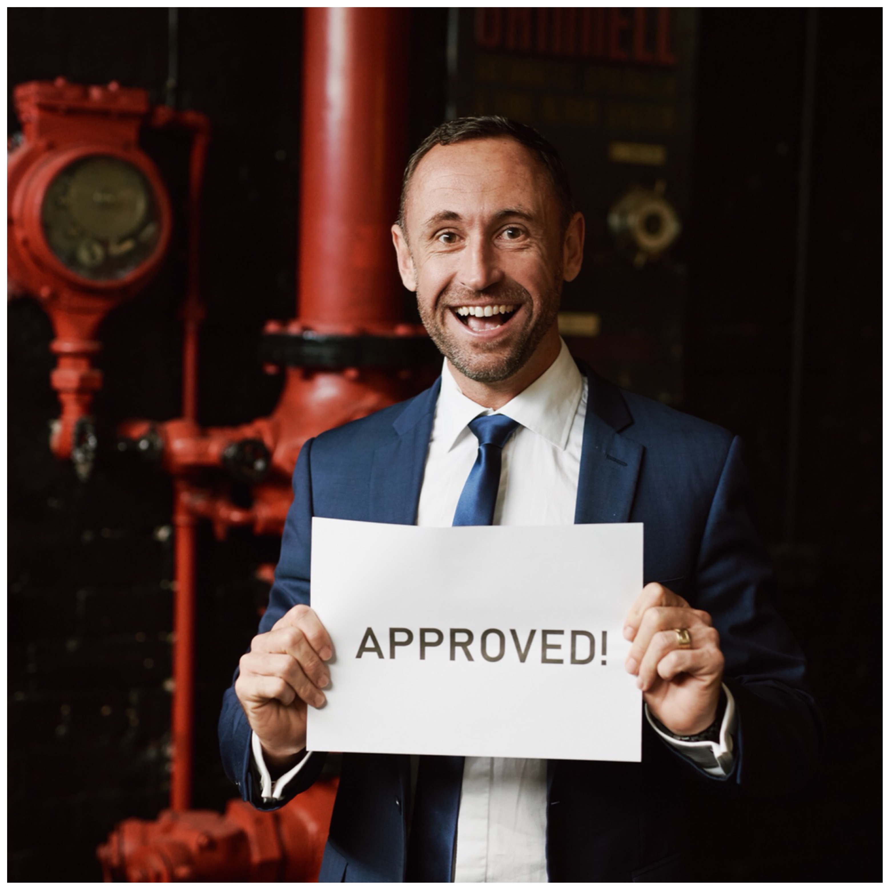Mortgage Broker and home loans Lake Macquarie concept - Heath holding up 'approved' sign